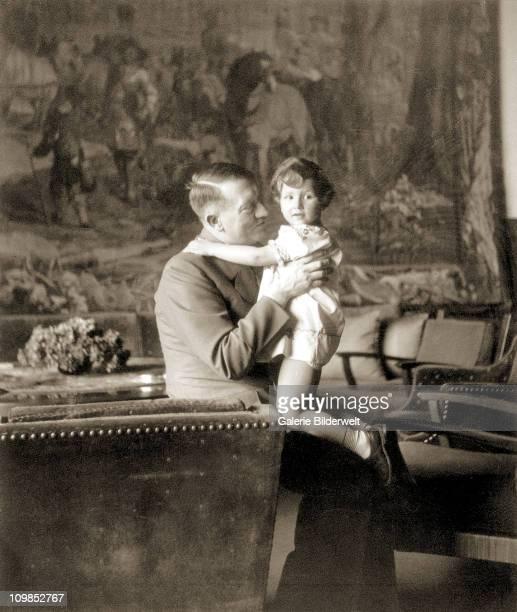 Adolf Hitler and Uschi Schneider the daughter of Herta Schneider a close childhood friend of Eva Braun at the Berghof Berchtesgaden Germany 1942...