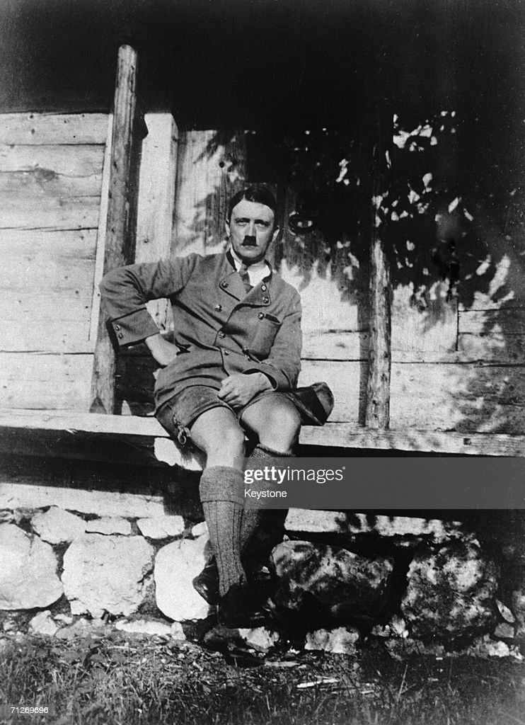 Adolf Hitler (1889 - 1945), Chancellor of Germany from 1933, on the porch of a rustic cabin, circa 1930.