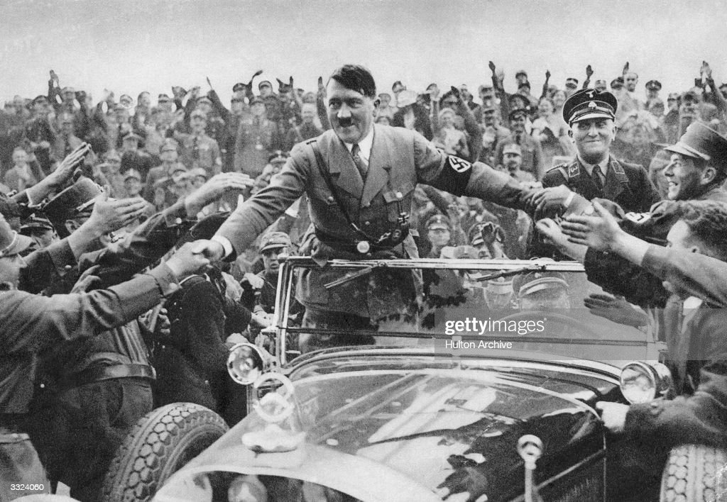 Adolf Hitler (1889 - 1945), chancellor of Germany, is welcomed by supporters at Nuremberg.