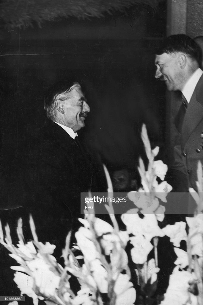 Adolf Hitler greets British Prime Minister Neville Chamberlain for a conference in Munich, Germany circa 1938.