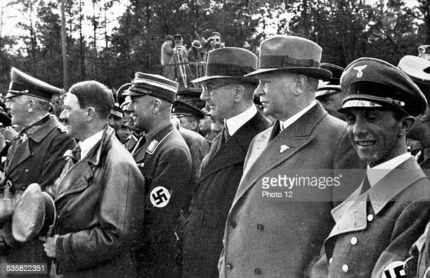 Adolf Hitler officiating at the opening of the FrankfurtDarmstadt highway L to r von Blomberg War minister Adolf Hitler Todt general inspector...