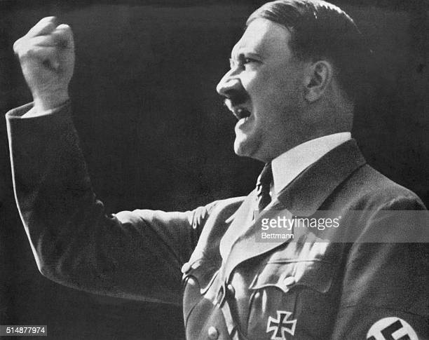 Adolf Hitler raises a defiant clenched fist during a speech