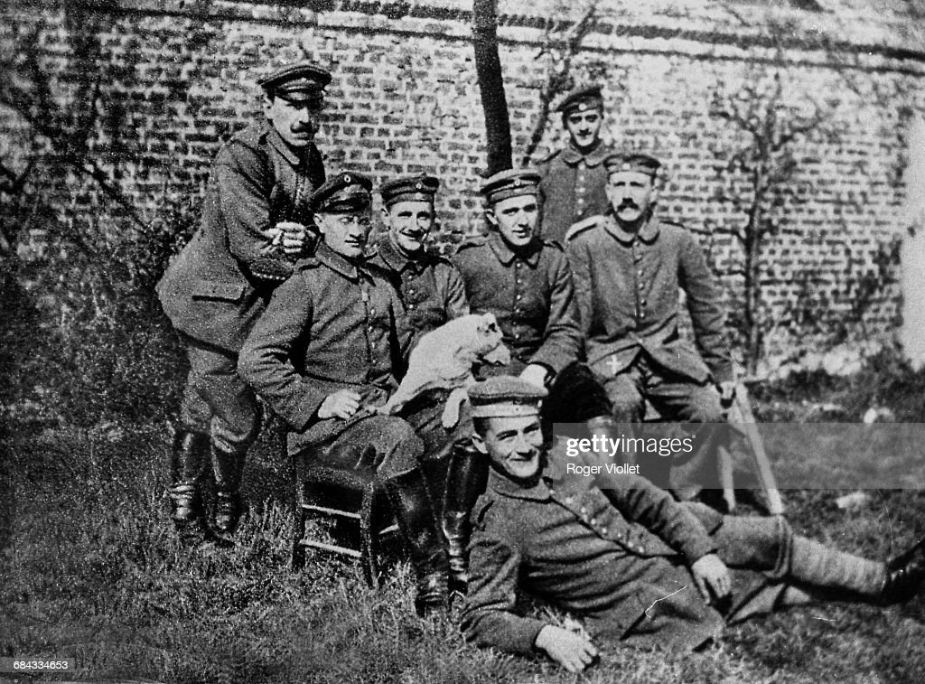 Adolf Hitler (far right, seated), whilst enlisted in the Bavarian Army, in the 16th infantry regiment, World War I, 1914.