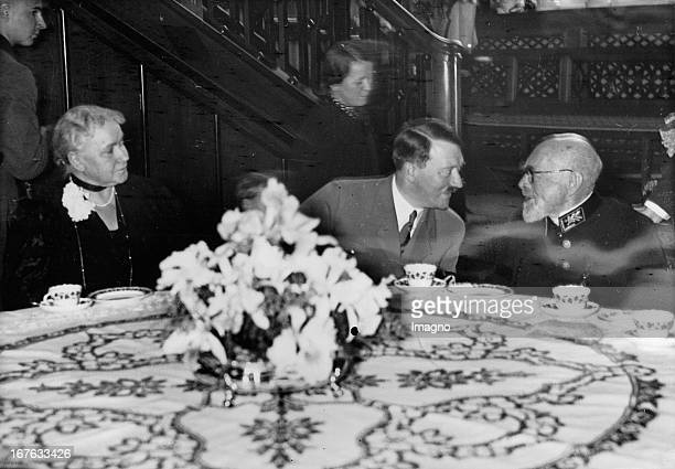 Adolf Hitler with Geheimrat Emil Kirdorf and his wife On their estate Streithof near Mülheim April 9th 1937 Photograph Adolf Hitler mit Geheimrat...