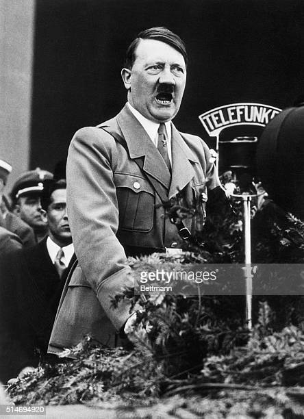 Adolf Hitlercloseup shot of the Chancellor speaking over the radio microphone