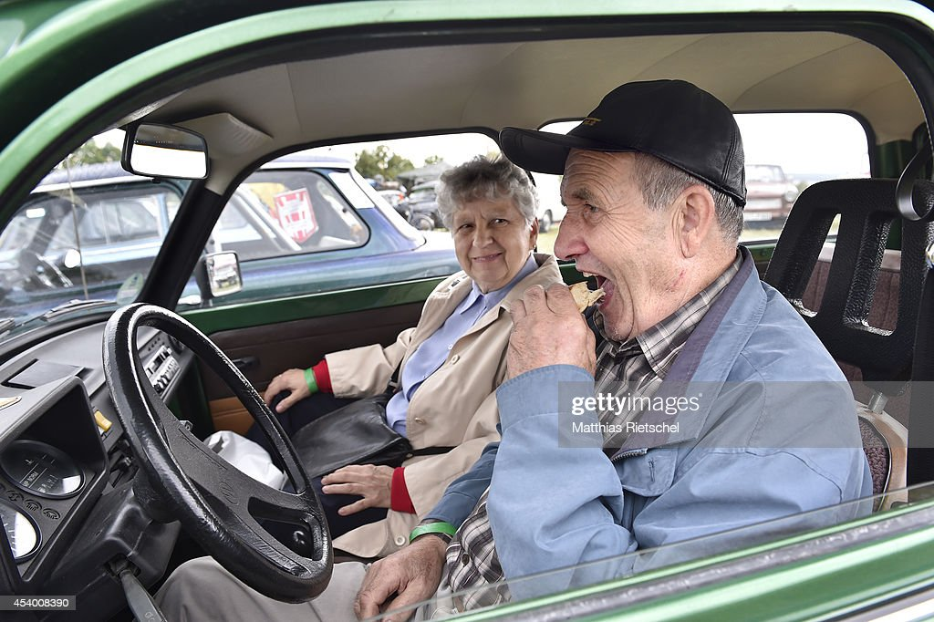 Adolf Kirchner and his wife Anita Kirchner have breakfast while sitting in their Trabant car, built 1991, as fans of the East German Trabant car gather for their 7th annual get-together on August 23, 2014 in Zwickau, Germany. Hundreds of Trabant enthusiasts arrived to spend the weekend admiring each others cars, trading stories and enjoying activities. The Trabant, dinky and small by modern standards, was the iconic car produced in former communist East Germany and today has a strong cult following.