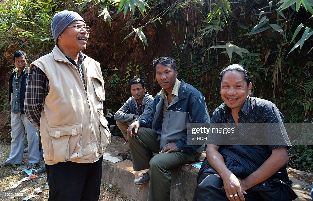 Adolf Lu Hitler-Marak (2L), an Indian candidate for local assembly elections, speaks with a group of men as he campaigns in Bajengdoba in the northeastern state of Meghalaya on February 21, 2013. Politicians named after Adolf Hitler and Frankenstein are among 345 candidates competing in elections this week in a north-east Indian state with a history of bizarre naming conventions.