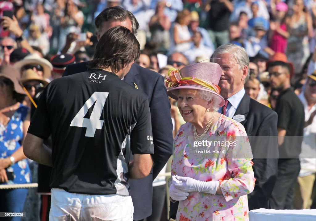 Adolfo Cambiaso, Laurent Feniou, Queen Elizabeth II and Jock Green-Armytage attend the Cartier Queen's Cup Polo final at Guards Polo Club on June 18, 2017 in Egham, England.