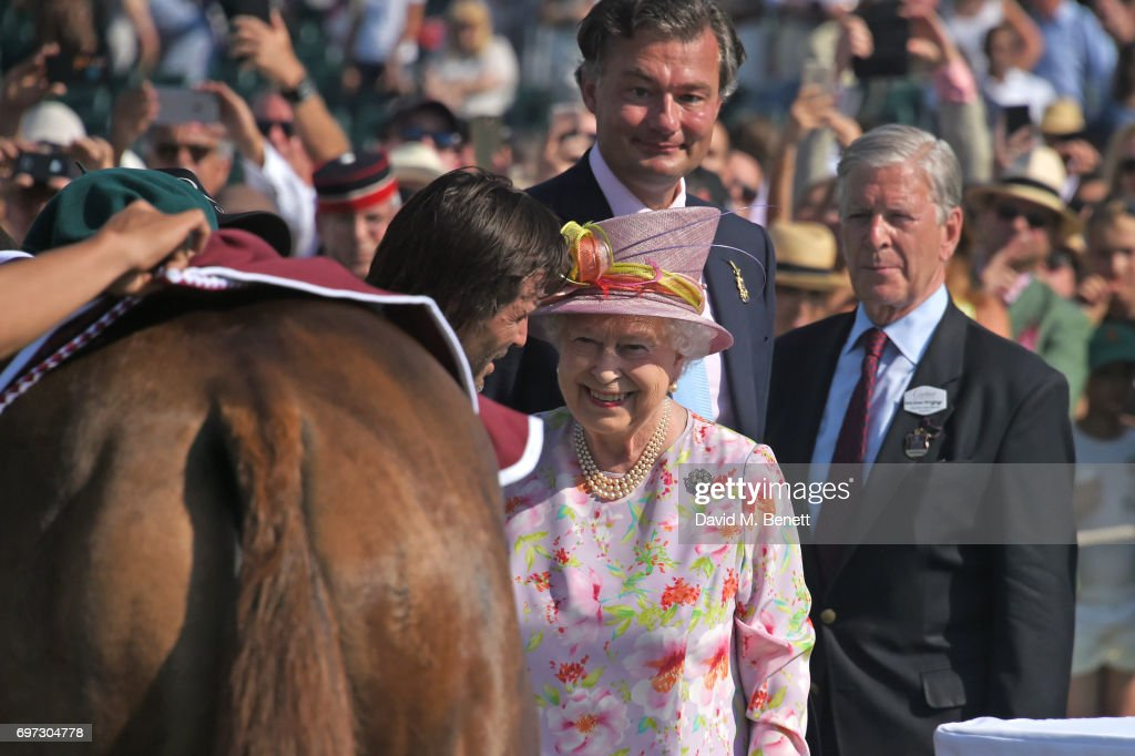 Adolfo Cambiaso, Queen Elizabeth II, Laurent Feniou and Jock Green-Armytage attend the Cartier Queen's Cup Polo final at Guards Polo Club on June 18, 2017 in Egham, England.
