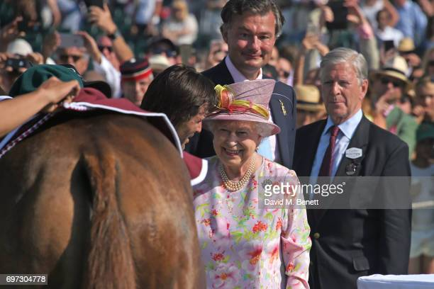 Adolfo Cambiaso Queen Elizabeth II Laurent Feniou and Jock GreenArmytage attend the Cartier Queen's Cup Polo final at Guards Polo Club on June 18...