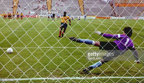 Adolfo Valencia of Colombia scores the game winning goal on a penalty shot 26 June 1993 against the Uruguayan goalie The quarterfinal Copa America...