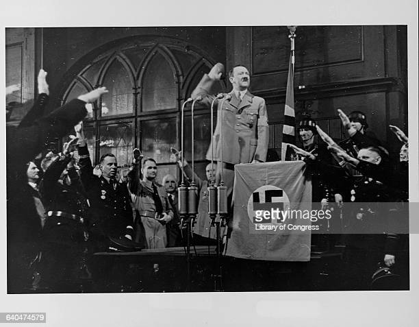Adolph Hitler and German military leaders exchange the Nazi salute at a Munich celebration | Location Hofbrauhausse Munich Germany