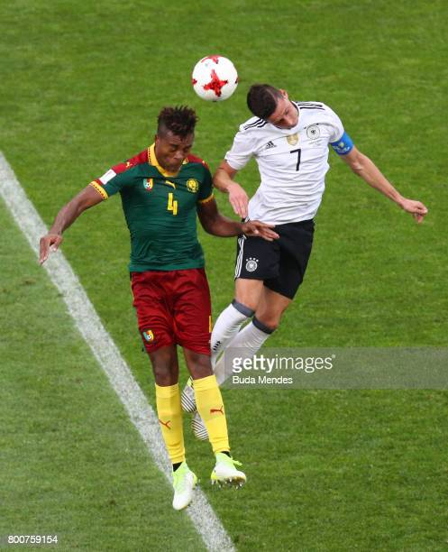 Adolphe Teikeu of Cameroon and Julian Draxler of Germany battle to win a header during the FIFA Confederations Cup Russia 2017 Group B match between...