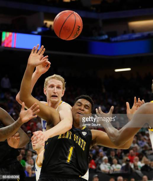 Adonis De La Rosa of the Kent State Golden Flashes battles for the ball with Thomas Welsh of the UCLA Bruins during the first round of the 2017 NCAA...