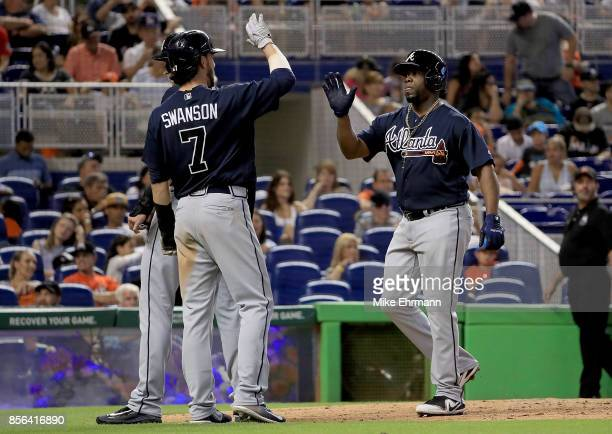 Adonis Garcia of the Atlanta Braves is congratulated after hitting a three run home run in the seventh inning during a game against the Miami Marlins...
