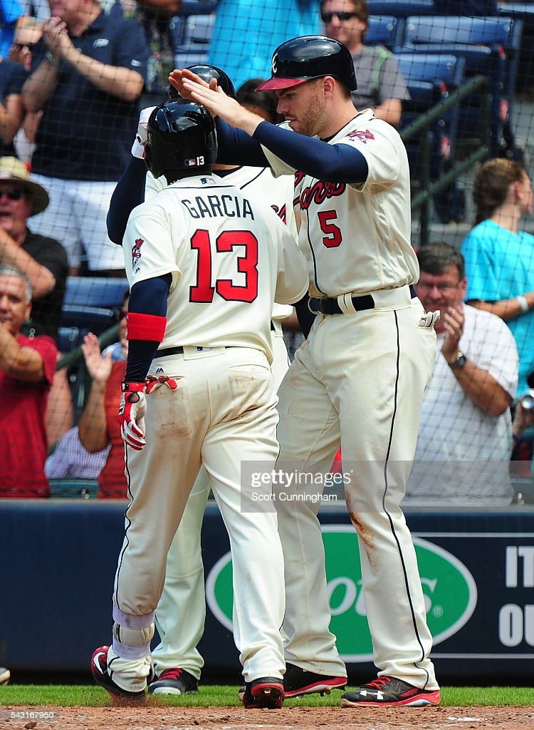 Adonis Garcia #13 of the Atlanta Braves is congratulated by <a gi-track='captionPersonalityLinkClicked' href=/galleries/search?phrase=Freddie+Freeman&family=editorial&specificpeople=5743987 ng-click='$event.stopPropagation()'>Freddie Freeman</a> #5 after hitting a three-run home run in the eighth inning against the New York Mets at Turner Field on June 26, 2016 in Atlanta, Georgia.
