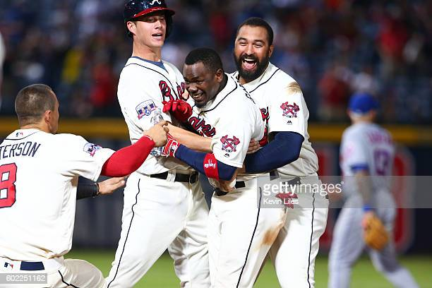 Adonis Garcia of the Atlanta Braves is congratulated for making the gamewinning hit against the New York Mets during the 10th inning at Turner Field...