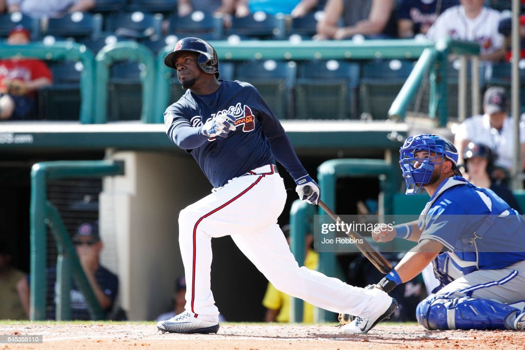 Adonis Garcia #13 of the Atlanta Braves singles in a run in the fourth inning during the spring training game at Champion Stadium on February 25, 2017 in Lake Buena Vista, Florida. The Braves defeated the Blue Jays 7-4.