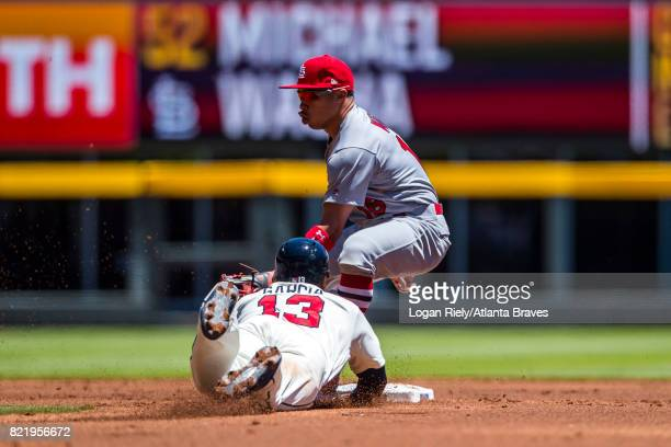 Adonis Garcia of the Atlanta Braves slides into second base against the St Louis Cardinals at SunTrust Park on May 7 2017 in Atlanta Georgia The...
