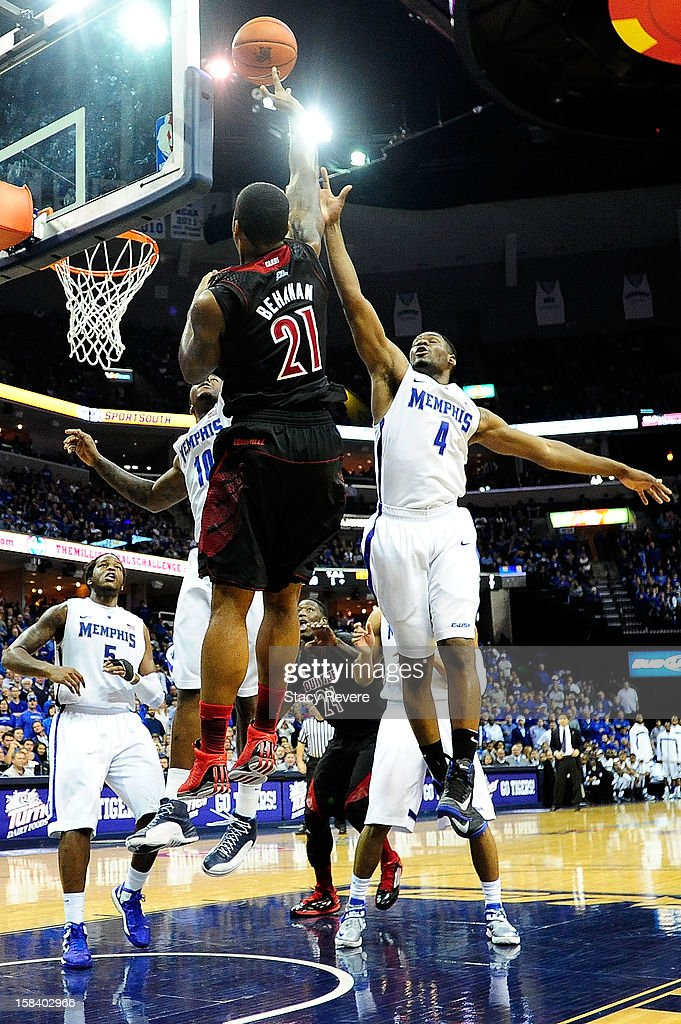 Adonis Thomas #4 of the Memphis Tigers defends a shot by Chane Behanan #21 of the Louisville Cardinals during a game at FedExForum on December 15, 2012 in Memphis, Tennessee.