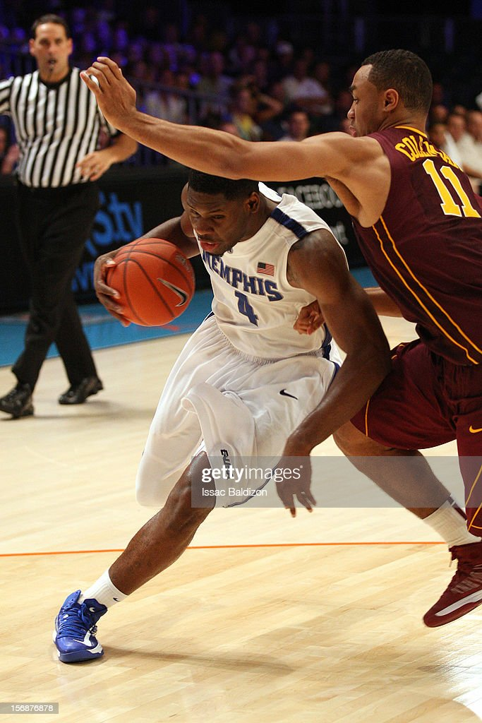 Adonis Thomas #4 of the Memphis Tigers drives against Joe Coleman #11 of the Minnesota Gophers during the Battle 4 Atlantis tournament at Atlantis Resort November 23, 2012 in Nassau, Paradise Island, Bahamas.