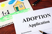Adoption form and children's picture. (I am owner of picture.)