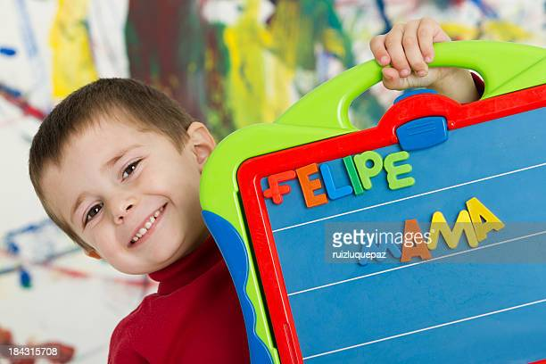 Adorable boy learning the letters in spanish
