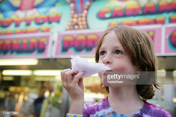 Adorable Child Eating Cotton Candy at the Fair