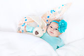 http://www.istockphoto.com/photo/adorable-cute-newborn-baby-girl-with-easter-bunny-toy-gm655797070-119314337