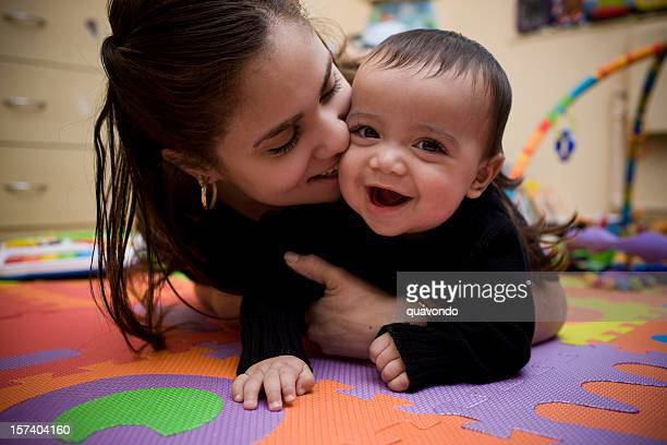 Adorable Hispanic Young Mother and Son in Home Playroom