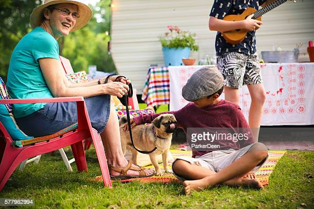 Adorable Little Boy and Pug Dog Camping with Friends
