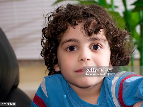 boy with curly brown hair stock photos and pictures