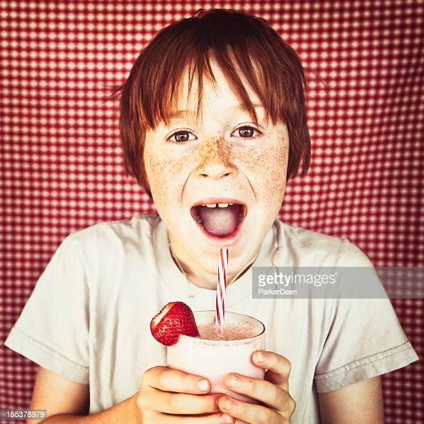 Adorable Little Boy with Homemade Organic Strawberry Smoothie