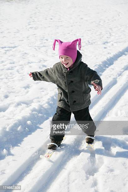 Adorable Little Girl Cross Country Skiing for the First Time