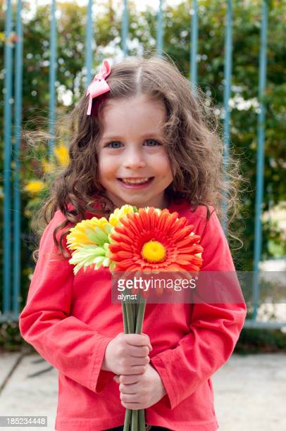 Adorable Little girl Holding Flowers