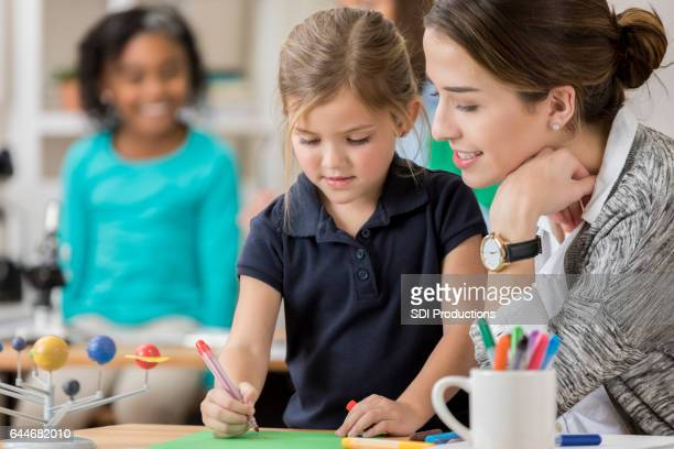 Adorable little girl participates in art class