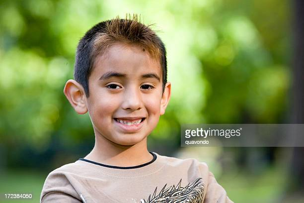 Adorable Little Hispanic Boy Crossing Arms Outside, Portrait