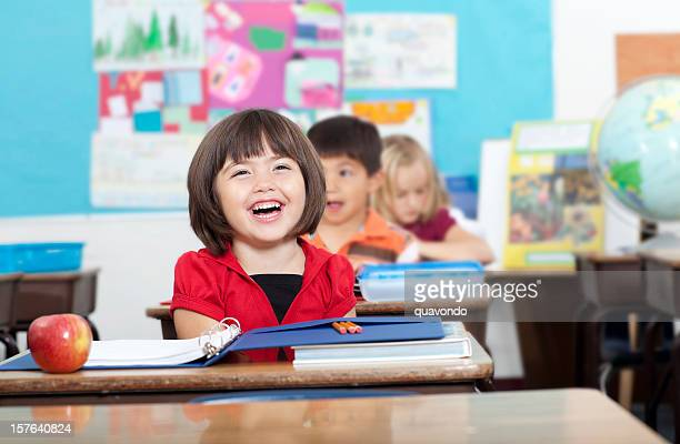 Adorable Mixed Elementary School Girl Laughing in Classroom, Copy Space