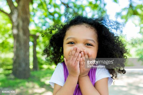 Adorable mixed race girl in the park