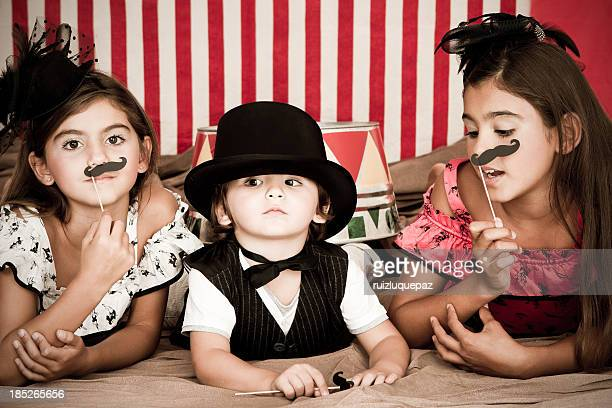 Adorable ringmaster with assistants
