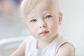 Adorable toddler girl portrait at summer