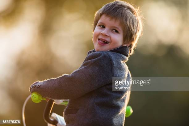 adorable young boy with a bike