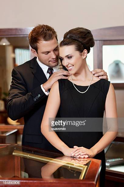 Adorable Young Couple with Necklace Gift in Jewelry Store