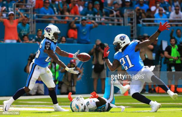 Adoree' Jackson and Da'Norris Searcy of the Tennessee Titans break up a pass intended for Jakeem Grant of the Miami Dolphins in the first quarter on...
