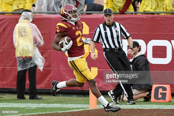 Adoree' Jackson of the USC Trojans carries the ball for a touchdown in the third quarter against the Notre Dame Fighting Irish at Los Angeles...