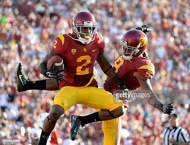 Adoree' Jackson of the USC Trojans celebrates his touchdwon with JuJu Smith to take a 317 lead over the Fresno State Bulldogs during the second...