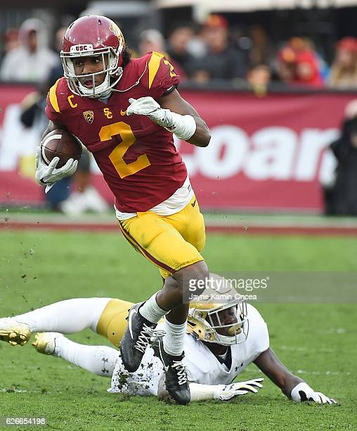 Adoree' Jackson of the USC Trojans gets past Spencer Perry of the Notre Dame Fighting Irish as he heads to the end zone for a touch down in the third...