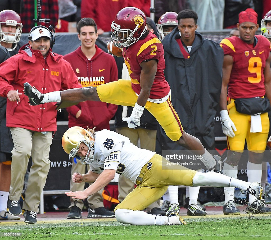 Adoree' Jackson #2 of the USC Trojans hurdles John Chereson #43 of the Notre Dame Fighting Irish as he heads to the end zone on a 96 yard touch down run in the third quarter of the game at the Los Angeles Memorial Coliseum on November 26, 2016 in Los Angeles, California.
