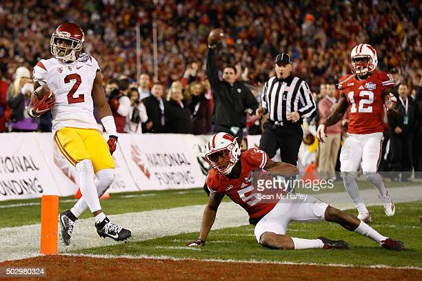 Adoree' Jackson of the USC Trojans reacts after running past Darius Hillary of the Wisconsin Badgers and Natrell Jamerson of the Wisconsin Badgers...