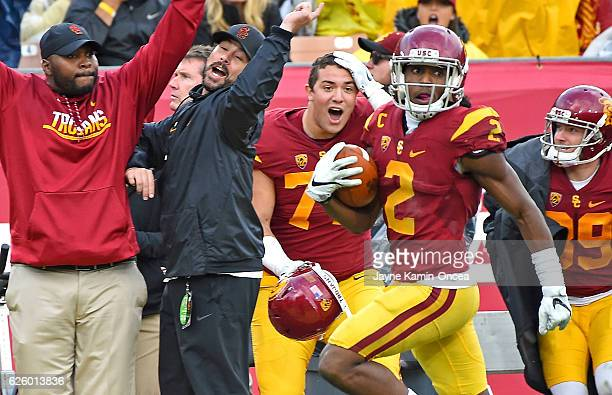Adoree' Jackson of the USC Trojans runs down the sideline on a 96 yard touch down run in the third quarter of the game against the Notre Dame...